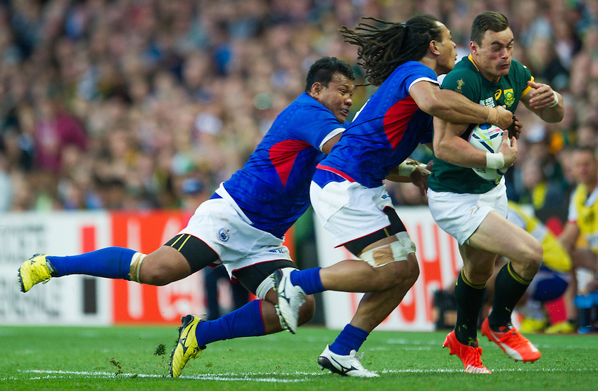 South Africa's Jesse Kriel is tackled by Samoa's TJ Ioane<br /> <br /> Photographer Craig Thomas /CameraSport<br /> <br /> Rugby Union - 2015 Rugby World Cup Pool B  South Africa v Samoa - Saturday 26th September 2015 - Villa Park - Birmingham<br /> <br /> &copy; CameraSport - 43 Linden Ave. Countesthorpe. Leicester. England. LE8 5PG - Tel: +44 (0) 116 277 4147 - admin@camerasport.com - www.camerasport.com