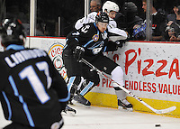 Milwaukee Admirals defenseman Joe Piskula tangles with San Antonio Rampage left wing Eric Selleck during the second period of an AHL hockey game, Thursday, Jan. 16, 2014, in San Antonio. (Darren Abate/AHL)