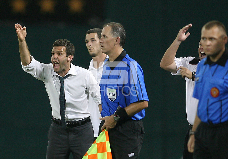 Coaches Ben Olsen and Chad Ashton of D.C. United protest a referee's decision during a US Open Cup semi final match against the Columbus Crew at RFK Stadium on September 1 2010, in Washington DC. Columbus won 2-1 aet.