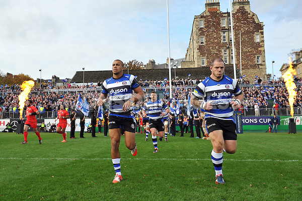 Jonathan Joseph, Paul James and the rest of the Bath team run out onto the field. European Rugby Champions Cup match, between Bath Rugby and Toulouse on October 25, 2014 at the Recreation Ground in Bath, England. Photo by: Patrick Khachfe / Onside Images