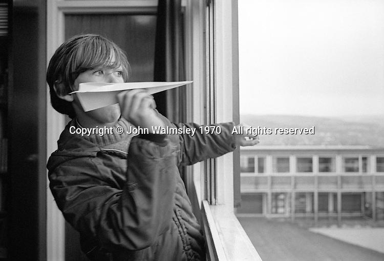 Flying a paper aeroplane, Whitworth Comprehensive School, Whitworth, Lancashire.  1970.