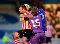 Lincoln City's Matt Rhead vies for possession with Port Vale's Nathan Smith, centre, and Port Vale's Antony Kay<br /> <br /> Photographer Chris Vaughan/CameraSport<br /> <br /> The EFL Sky Bet League Two - Lincoln City v Port Vale - Tuesday 1st January 2019 - Sincil Bank - Lincoln<br /> <br /> World Copyright &copy; 2019 CameraSport. All rights reserved. 43 Linden Ave. Countesthorpe. Leicester. England. LE8 5PG - Tel: +44 (0) 116 277 4147 - admin@camerasport.com - www.camerasport.com