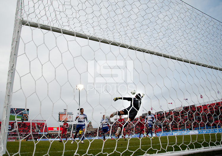 06 April 2013: Toronto FC midfielder Darel Russell #16 scores the equalizer past FC Dallas goalkeeper Raul Fernandez #1late in the game during an MLS game between FC Dallas and Toronto FC at BMO Field in Toronto, Ontario Canada..The game ended in a 2-2 draw..