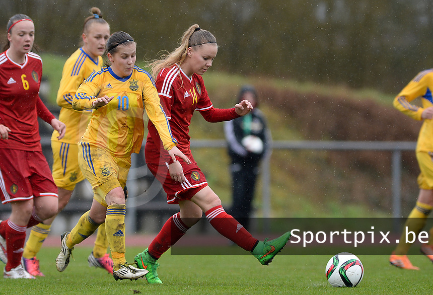 20150404 - FORST , GERMANY  : Belgian Tabitha Lingier (14) pictured in action with Ukrainian Viktoriia Holovach (left) in her back during the soccer match between Women Under 19 teams of Belgium and Ukraine , on the first matchday in group 5 of the UEFA Elite Round Women Under 19 at WaldseeStadion , Forst , Germany . Saturday 4th April 2015 . PHOTO DAVID CATRY