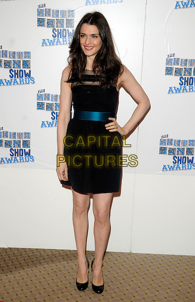 RACHEL WEISZ.The South Bank Show Awards, Dorchester Hotel, London, England..January 26th, 2010.full length black blue dress sash waist sleeveless sheer hand on hip navy .CAP/CAN.©Can Nguyen/Capital Pictures.