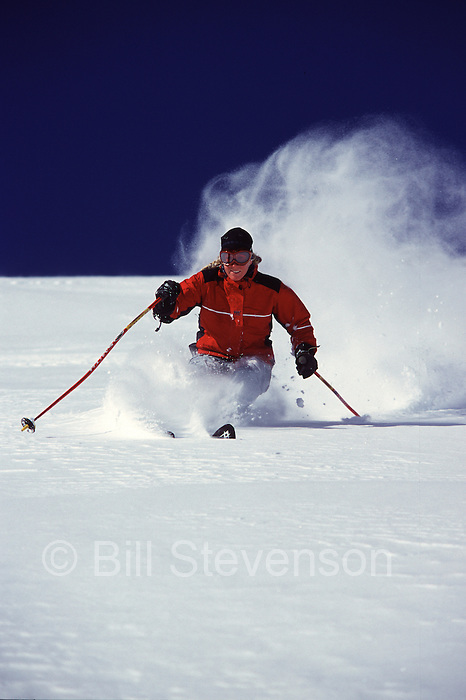An image of a woman skiing powder snow at Alpine Meadows, Ca.