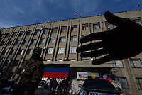 """No cameras"" - pro-russian activists, members of the Civil army of Donbas protecting the city hall in Slavyansk city. Donetsk region.  Ukraine"