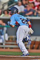 Tennessee Smokies designated hitter Rafael Lopez #29 runs to first during a game against the Birmingham Barons at Smokies Park on May 31, 2014 in Kodak, Tennessee. The Barons defeated the Smokies 2-1. (Tony Farlow/Four Seam Images)