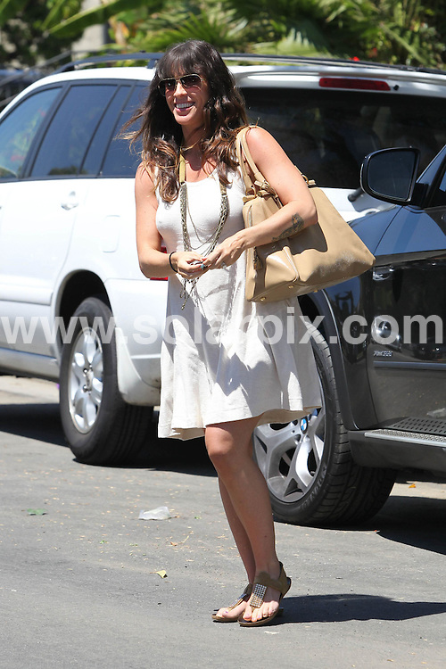 **ALL ROUND PICTURES FROM SOLARPIX.COM**.**SYNDICATION RIGHTS FOR UK, AUSTRALIA, DENMARK, PORTUGAL, S. AFRICA, SPAIN & DUBAI (U.A.E) & ASIA (EXCLUDING JAPAN) ONLY**.Alanis Morissette Running Errands In Beverly Hills, CA, USA, 19 August 2010.This pic: Alanis Morissette..JOB REF: 11958    PHZ candids  DATE: 19_08_2010 .**MUST CREDIT SOLARPIX.COM OR DOUBLE FEE WILL BE CHARGED**.**MUST NOTIFY SOLARPIX OF ONLINE USAGE**.**CALL US ON: +34 952 811 768 or LOW RATE FROM UK 0844 617 7637**