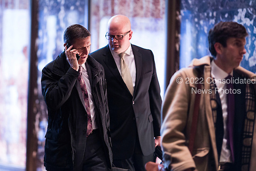 Michael Flynn (L) arrives at Trump Tower in Manhattan, New York, U.S., on Thursday, January 12, 2017. <br /> Credit: John Taggart / Pool via CNP