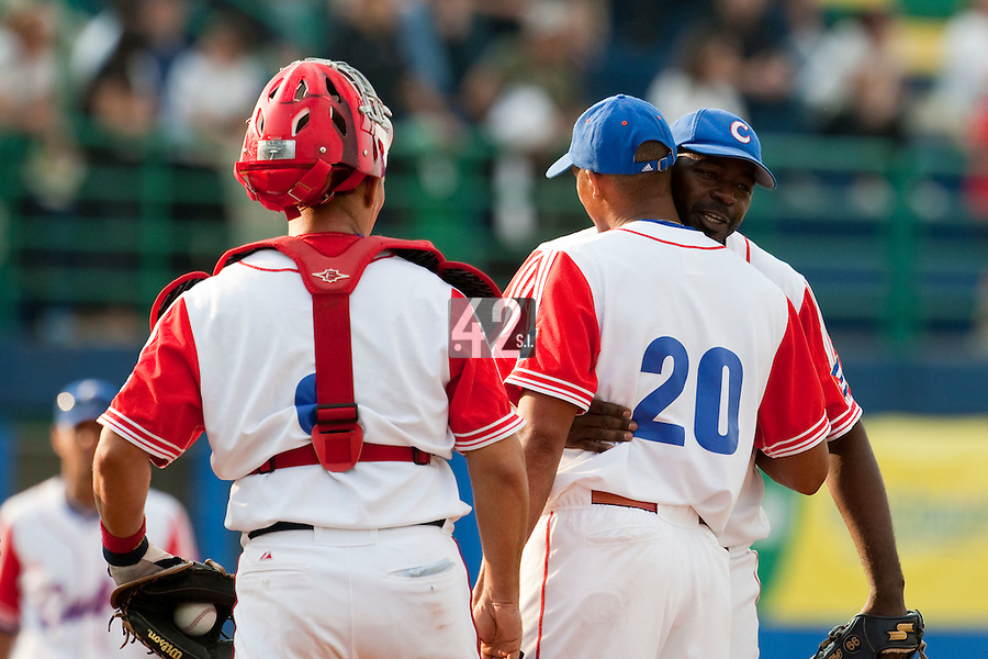 27 September 2009: Pedro Lazo of Cuba congratulates Norge Vera during the 2009 Baseball World Cup gold medal game won 10-5 by Team USA over Cuba, in Nettuno, Italy.