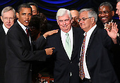 United States President Barack Obama greets Rep. Barney Frank (R) (D-MA) and Sen. Chris Dodd (C) (D-CT) after signing the Dodd-Frank Wall Street Reform and Consumer Protection Act at the Ronald Reagan Building, Wednesday, July 21, 2010 in Washington, DC. The bill is the strongest financial reform legislation since the Great Depression and also creates a consumer protection bureau that oversees banks on mortgage lending and credit card practices..Credit: Win McNamee - Pool via CNP