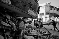 Port au Prince, Haiti, Jan 16 2010.Thousands of bodies are still trapped under the rubble, the stench is unbearable.
