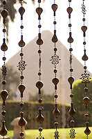 An Eyptian Pyramid seen through hanging beads, Giza, Egypt