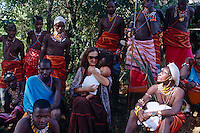 Anna and Lemarti with their baby surrounded by Masai