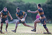 Peni Buakula makes a run across field past  Kolo Vea. Counties Manukau Premier Club Rugby game between Pukekohe and Bombay played in very wet conditions at Colin Lawrie Fields Pukekohe on Saturday 18th June 2011. Pukekohe won 61 - 0 after leading 31 - 0 at halftime.