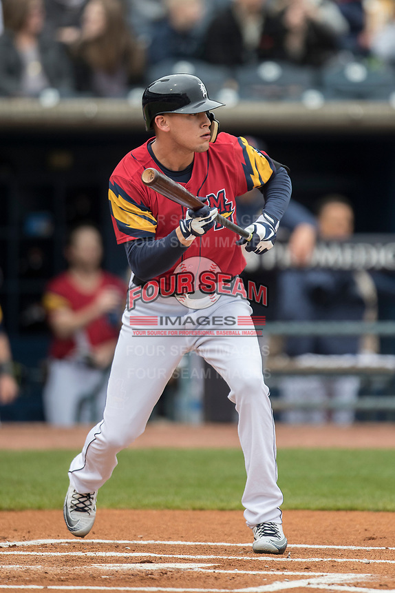 Toledo Mud Hens outfielder Jacoby Jones (4) squares to bunt against the Lehigh Valley IronPigs during the International League baseball game on April 30, 2017 at Fifth Third Field in Toledo, Ohio. Toledo defeated Lehigh Valley 6-4. (Andrew Woolley/Four Seam Images)
