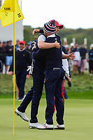 Daniel Berger (USA) and Justin Thomas (USA) celebrate winning their match during round 3 Four-Ball of the 2017 President's Cup, Liberty National Golf Club, Jersey City, New Jersey, USA. 9/30/2017.<br /> Picture: Golffile | Ken Murray<br /> <br /> All photo usage must carry mandatory copyright credit (&copy; Golffile | Ken Murray)