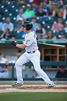 Zack Collins (8) of the Charlotte Knights follows through on his swing against the Toledo Mud Hens at BB&T BallPark on April 24, 2019 in Charlotte, North Carolina. The Knights defeated the Mud Hens 9-6. (Brian Westerholt/Four Seam Images)