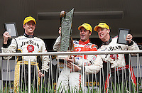 Race Two Podium winners: Second-placed James Courtney, winner Jamie Whincup with the Mark Porter Trophy and third-placed Steven Johnson during Day Three of the Hamilton 400 Aussie V8 Supercars Round Two at Frankton, Hamilton, New Zealand on Sunday, 19 April 2009. Photo: Dave Lintott / lintottphoto.co.nz