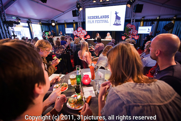 The Netherlands, Utrecht, 25 September 2011. The Netherlands Film Festival 2011. Smaakmakers programme, with actress Anna Drijver (left) and host Jan Eilander at festival center. Photo: 31pictures.nl / Nederland, Utrecht, 25 september 2011. Het Nederlands Film Festival 2011. In het programma; Smaakmakers met actrice Anna Drijver (links) en host Jan Eilander in het Festival paviljoen. Foto: 31pictures.nl / (c) 2011, www.31pictures.nl