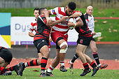 looks to bust between Faalae Peni and Jamie Harford. Counties Manukau Premier Club Rugby game between Papakura and Karaka played at Massey Park Papakura on Saturday May 5th 2018. Papakuar won the game 28 - 25 after trailing 6 - 12 at halftime.<br /> Papakura - Faalae Peni, Darryl Hemopo, George Crichton, Federick Cain tries, Faalae Peni conversion; Faalae Peni 2 penalties, Karaka -Salesitangi Savelio, Cardiff Vaega, Walter Fifita tries, Juan Benadie 2 conversions, Juan Benadie 2 penalties.<br /> Photo by Richard Spranger.