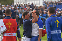 Sergio Garcia (Team Europe) hugs Rickie Fowler (Team USA) following their match on 17 following Sunday's singles of the 2018 Ryder Cup, Le Golf National, Guyancourt, France. 9/30/2018.<br /> Picture: Golffile | Ken Murray<br /> <br /> <br /> All photo usage must carry mandatory copyright credit (© Golffile | Ken Murray)