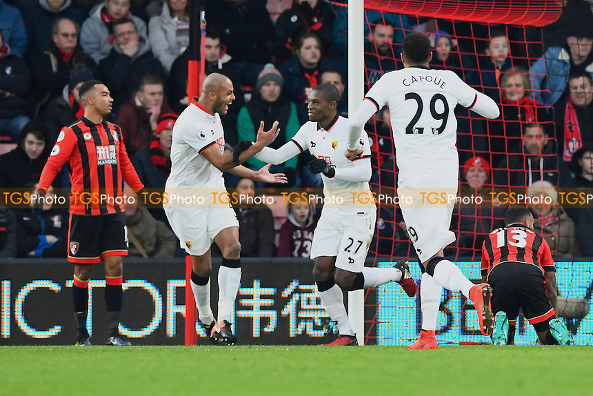 Younes Kaboul of Watford left congratulates goalscorer Christian Kabasele of Watford during AFC Bournemouth vs Watford, Premier League Football at the Vitality Stadium on 21st January 2017