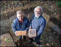 BNPS.co.uk (01202 558833)<br /> Pic: PhilYeomans/BNPS<br /> <br /> Archaeologist Robin Holley and Graham Bathe with Tudor tiles in the rediscovered foundations of Wolf Hall. <br /> <br /> Historic Wolf Hall, home to the Seymour family and star of Hilary Mantel's famous trilogy on Henry VIII th, has finally been definitively located after new discoveries around the much smaller ramshackle house that remains today. <br /> <br /> Despite it's fame, nobody really knew where the enormous Tudor pile actually was, or what it looked like, due to its very short but very influential existance in the middle of the tumultuous 16th century.<br /> <br /> Built with a million pound loan (&pound;2,400) from King Henry in 1531, brokered by Thomas Cromwell, the huge house was rapidly brick built in time for the King's pivotal visit with the court and troublesome wife Anne Boleyn in 1535, at which point Sir John Seymour's daughter Jane caught his eye, within a year Anne was dead and Jane, and the rest of the Seymour clan were in.<br /> <br /> They benefitted massively from Royal patronage and the dissolution of the monastries, but it all went wrong when Henry died and the brothers fell out and were later executed in a spectacular fall from power only 21 years after the house was built.<br /> <br /> Historian Graham Bathe and his team have now uncovered part of the outline of the original building, as well as the extensive Tudor brick sewer system that proves the huge scale of the 16th century mansion.