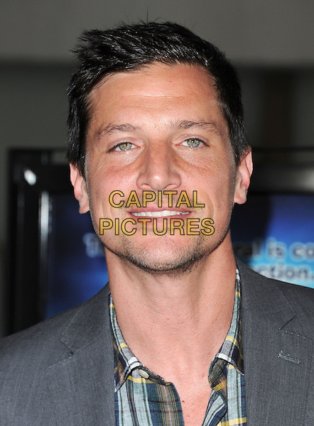 Simon Rex.at The Dimension Films Premiere of 'Scary Movie 5' held at The Cinerama Dome in Hollywood, California, USA, April 11th 2013.                                                               .portrait headshot  grey gray plaid checked shirt .CAP/DVS.©Debbie VanStory/Capital Pictures