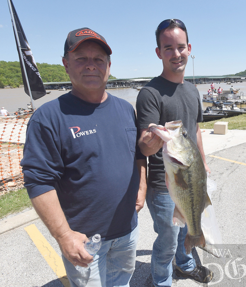 NWA Democrat-Gazette/FLIP PUTTHOFF <br /> Craig Berkshire (left) and Jared Berkshire show a 5.99-pound largemouth bass from their Saturday May 6 2017 catch at Beaver Lake.
