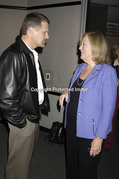 Robert Newman and Mary Alice Dwyer-Dobbin ..at at reception in honor of Mary Alice Dwyer-Dobbin on her ..leaving P and G on September 29, 2005 at the offices of ..P and G. ..Photo by Robin Platzer, Twin Images
