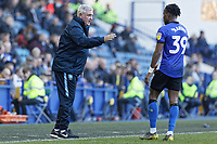 (L-R) Sheffield Wednesday manager Steve Bruce speaks to Rolando Aarons of Sheffield Wednesday during the Sky Bet Championship match between Sheffield Wednesday and Swansea City at Hillsborough Stadium, Sheffield, England, UK. Saturday 23 February 2019
