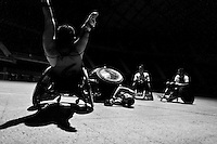 Moises Alonso crashes into Cristian Amaya during a wheelchair rugby training match at the indoor sporting arena Coliseo in Bogota, Colombia, 11 April 2013. Wheelchair rugby, a full-contact team sport, was developed in Canada in 1977 under the name murderball. The game is played only by athletes with some form of disability in both the upper and lower limbs (quadriplegics). Attempting to score by carrying the ball across the goal line, four players from each team roughly crash into each other in specially designed armored wheelchairs. Although the team from Bogota is supported by a foundation (gear), quad rugby players, mostly coming from the remote, socially deprived neighbourhoods, often can not attend a training due to lack of funds for transportation. However, they still dream of representing Colombia at Rio 2016 Paralympic Games.