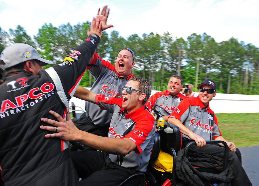May 6, 2012; Commerce, GA, USA: NHRA top fuel dragster driver Steve Torrence (left) celebrates with his crew after winning the Southern Nationals at Atlanta Dragway. Mandatory Credit: Mark J. Rebilas-