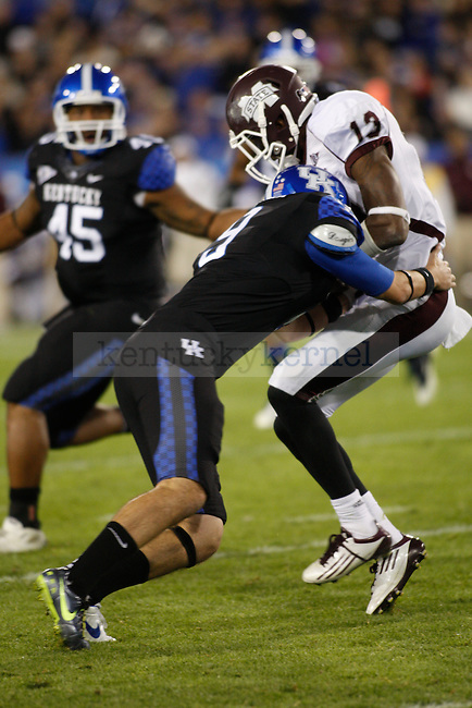 Mississippi State player gets hit by a UK defender during the second half of the UK's blackout home game against Mississippi State at Commonwealth in Lexington, Ky., Oct. 29, 2011. Mississippi State won 28-16. Photo by Brandon Goodwin | Staff