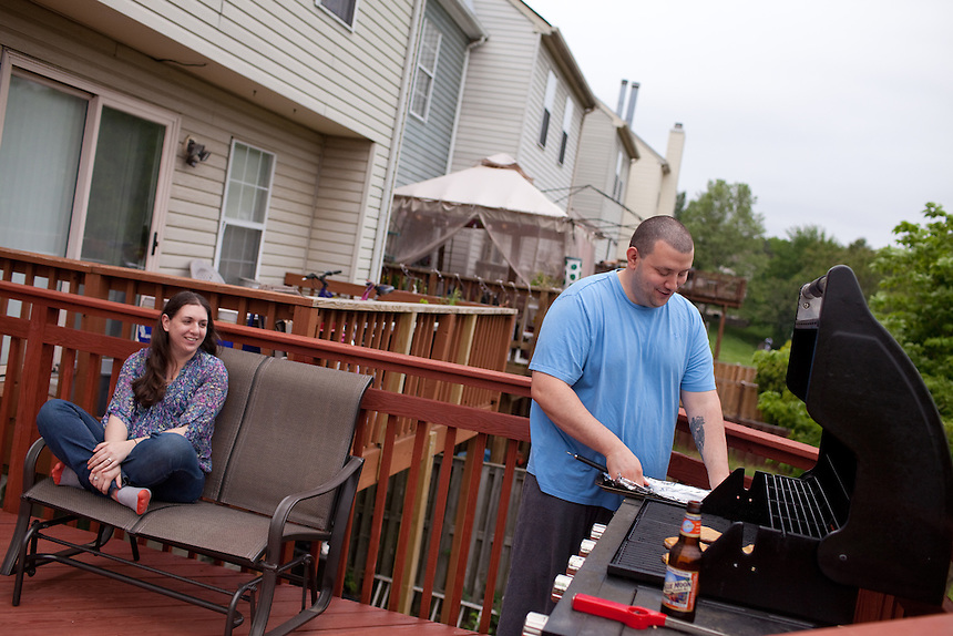 Stephen Yunis grills turkey burgers with his wife, Jenn Yunis, at their home in Germantown, Maryland on May 18, 2013. His wife, Jenn Yunis, has finally become pregnant after many attempts, with the help of Shady Grove Fertility Center in Rockville, Maryland.
