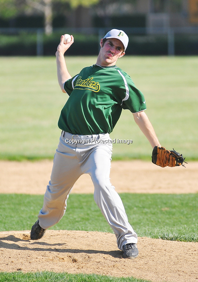 Pinewood Panthers pitcher Josh Rose winds up for a throw during the Panthers' loss to Harker April 23.
