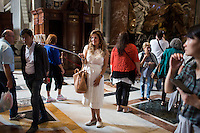 A woman uses a selfie stick inside St. Peter's Basilica during a tour of the Vatican on Thursday, Sept. 24, 2015. (Photo by James Brosher)
