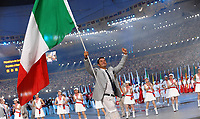 Antonio Rossi saluta il pubblico con la bandiera Italiana durante la sfilata degli atleti nel Bird Nest<br /> Pechino - Beijing 8/8/2008 Olimpiadi 2008 Olympic Games<br /> The Opening ceremony for the XXIX Olympic games.<br /> Cerimonia d'apertura delle Olimpiadi di Pechino 2008<br /> Foto Andrea Staccioli Insidefoto