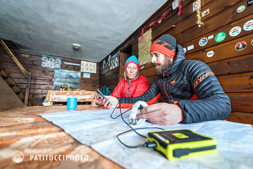 A ski tour through the Pirin Mountains of Bulgaria. Inside the Tevno Ezero Hut using a battery to charge a watch and use the phone.