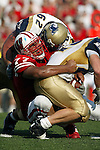 Madison, Wisconsin - 9/6/2003.  University of Wisconsin defensive lineman Anttaj Hawthorne (77) tackles University of Akron running back Bobby Hendry (42) during the game at Camp Randall. Wisconsin beat Akron 48-31. (Photo by David Stluka).