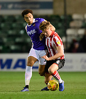 Lincoln City's Mark O'Hara vies for possession with Exeter City's Donovan Wilson<br /> <br /> Photographer Chris Vaughan/CameraSport<br /> <br /> The EFL Sky Bet League Two - Lincoln City v Exeter City - Tuesday 26th February 2019 - Sincil Bank - Lincoln<br /> <br /> World Copyright © 2019 CameraSport. All rights reserved. 43 Linden Ave. Countesthorpe. Leicester. England. LE8 5PG - Tel: +44 (0) 116 277 4147 - admin@camerasport.com - www.camerasport.com
