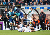 Joel Byrom of Mansfield Town slides in andfouls Adebayo Akinfenwa of Wycombe Wanderers during the Sky Bet League 2 match between Wycombe Wanderers and Mansfield Town at Adams Park, High Wycombe, England on the 14th April 2017. Photo by Liam McAvoy.