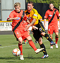 East Fife's Steven Campbell holds off Alloa's David Cox .