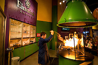 An employee of Discovery Place children's museum in Charlotte, NC, entertains visitors by performing experiments. He demonstrated the flamibility of lycopodium spores/powder.