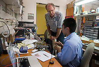 """Kevin Kuwata '15 works with Daniel Snowden-Ifft, Professor, Physics, on his project, """"Commissioning of Drift II-e Detector"""" as part of Occidental College's Summer Research Program, summer 2013. (Photo by Marc Campos, Occidental College Photographer)"""