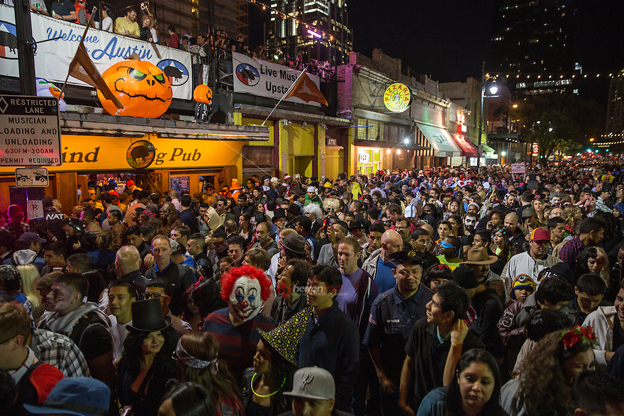 Costume revelers haunt the packed streets of 6th Street on Halloween in Austin, Texas. 6th Street Halloween in Austin is one of the most popular events you can visit in the city. Over 100,000 people dress up in costume and visit the bars on the infamous street.