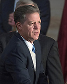 Governor Sam Brownback (Republican of Kansas) awaits the arrival of United States President Donald J. Trump as he attends a Congressional Gold Medal ceremony honoring former US Senator Bob Dole (Republican of Kansas) in the Rotunda of the US Capitol on Wednesday, January 17, 2017.  Congress commissioned gold medals as its highest expression of national appreciation for distinguished achievements and contributions.  Dole served in Congress from 1961 through 1996, was the Senate GOP leader from 1985 through 1996, and was the 1996 Republican Party nominee for President of the United States.<br /> Credit: Ron Sachs / CNP