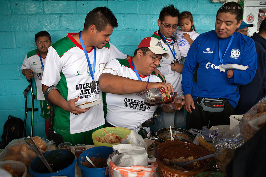 "Players from Guerreros Aztecas celebrate the team's first anniversary with family and friends in Mexico City, Mexico on July 5, 2014. Guerreros Aztecas (""Aztec Warriors"") is Mexico City's first amputee football team. Founded in July 2013 by five volunteers, they now have 23 players, seven of them have made the national team's shortlist to represent Mexico at this year's Amputee Soccer World Cup in Sinaloa this December. The team trains twice a week for weekend games with other teams. No prostheses are used, so field players missing a lower extremity can only play using crutches. Those missing an upper extremity play as goalkeepers. The teams play six per side with unlimited substitutions. Each half lasts 25 minutes. The causes of the amputations range from accidents to medical interventions – none of which have stopped the Guerreros Aztecas from continuing to play. The players' age, backgrounds and professions cover the full sweep of Mexican society, and they are united by the will to keep their heads held high in a country where discrimination against the disabled remains widespread. (Photo by Bénédicte Desrus)"